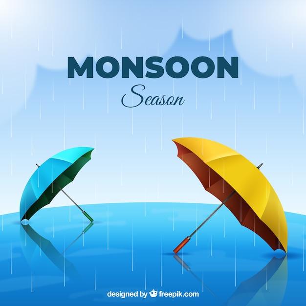 Het seizoenachtergrond van de moesson met realistische paraplu's Gratis Vector