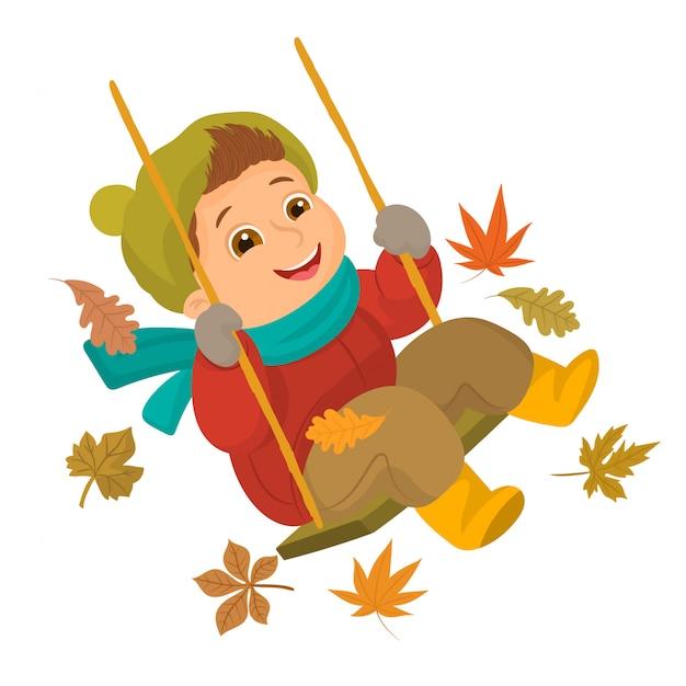 Het spelen van de jongen op een schommeling in de herfstseizoen Premium Vector