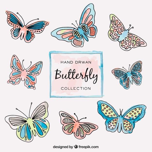 Het verzamelen van de hand getekende vlinders vliegen Gratis Vector