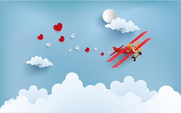 Het vliegtuig draagt de liefde die verspreid wordt. er zijn love-writing-banners. Premium Vector