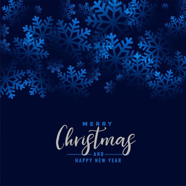 Het vrolijke blauw van kerstmis mooie sneeuwvlokken Gratis Vector