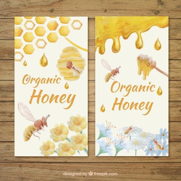 Honey banners beschilderd met waterverf Gratis Vector