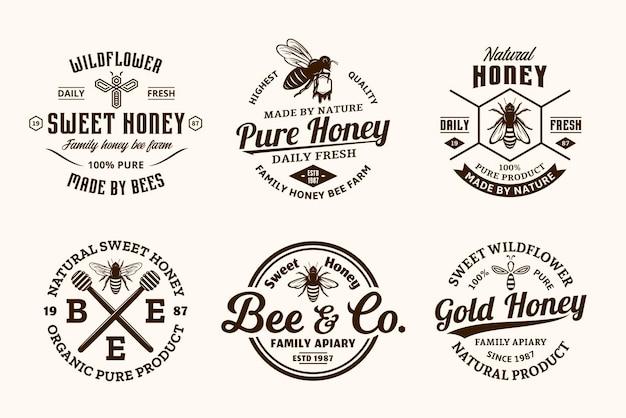 Honing vintage logo en pictogrammen voor honingproducten, bijenstal en bijenteelt branding en identiteit Premium Vector