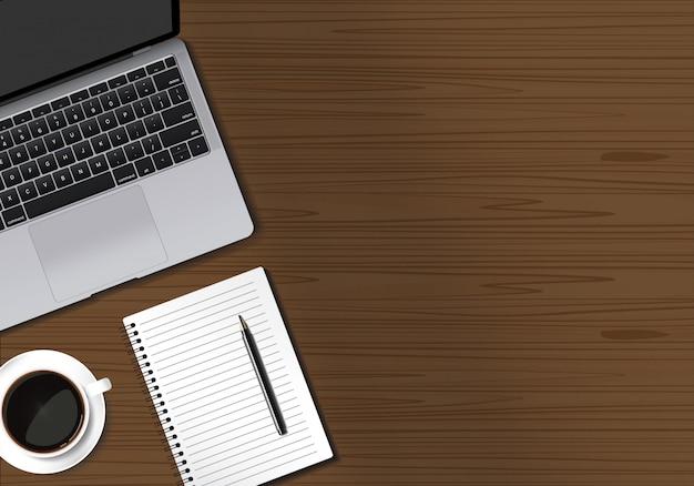 Houten tafelwerkruimte met laptop notitieboekjepen en koffiekop op bruine lijstachtergrond Premium Vector