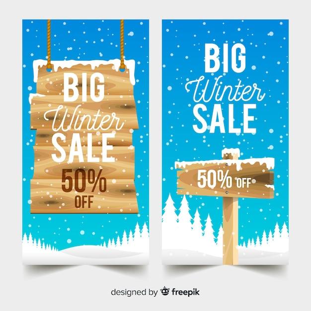 Houten teken winter verkoop spandoeksjabloon Gratis Vector