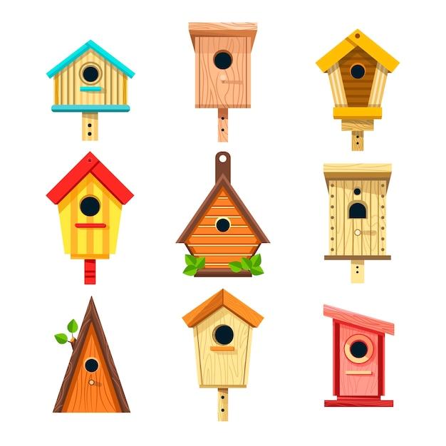 Houten vogelhuisjes geïsoleerde pictogrammen, nestkasten om aan boom te hangen Premium Vector