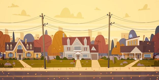 Huizenvoorstad van grote stad in de herfst, leuk de stadsconcept van plattelandshuisjevastgoed Premium Vector