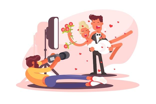Huwelijksfotograaf schiet op camera Premium Vector