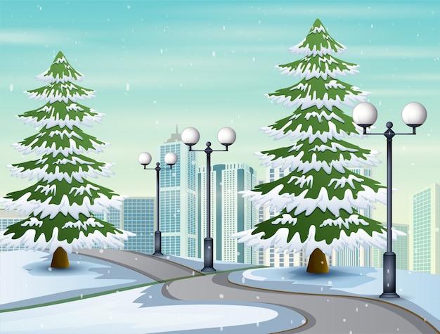 Illustratie van besneeuwde weg naar de stad Premium Vector