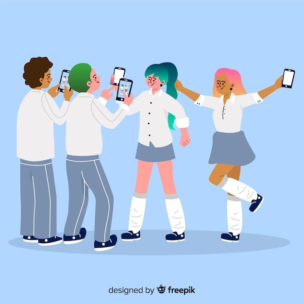Illustratie van jongeren die smartphones houden Gratis Vector