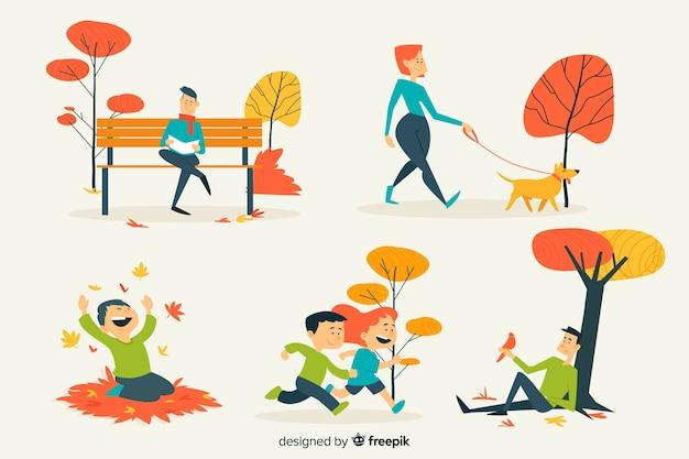 Illustratie van mensen in het de herfstpark Gratis Vector