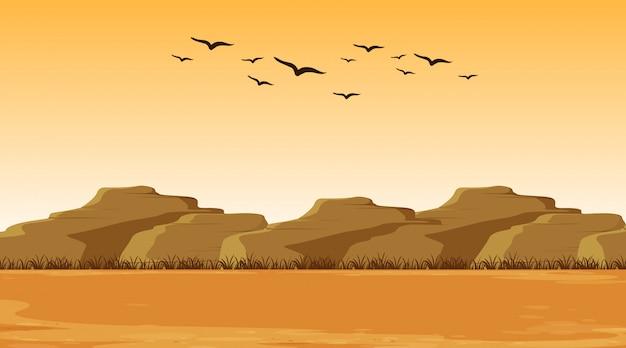 Illustratiescène met droog land en heuvels Gratis Vector