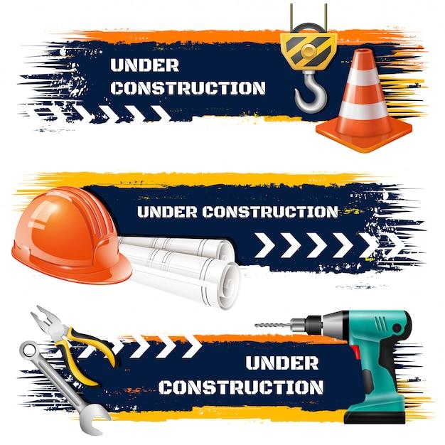 In aanbouw grunge banners met haak van de wegbarrière de beschermende helm van het opheffen van kraan realistische pictogrammen Gratis Vector