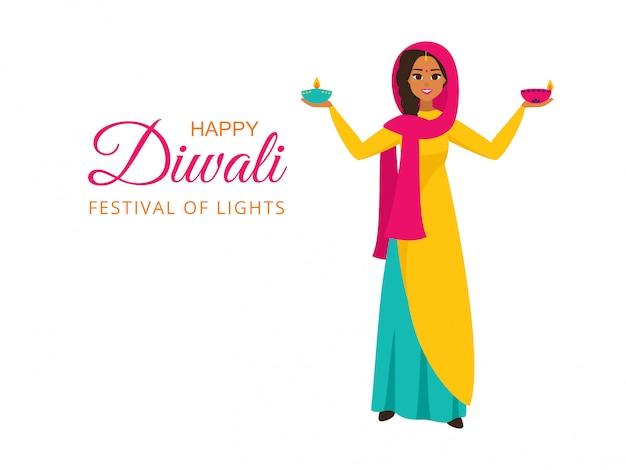 Indiase meisje in nationale kleding houdt verlichte lampen voor festival van lichten met een wens van gelukkige diwali Premium Vector