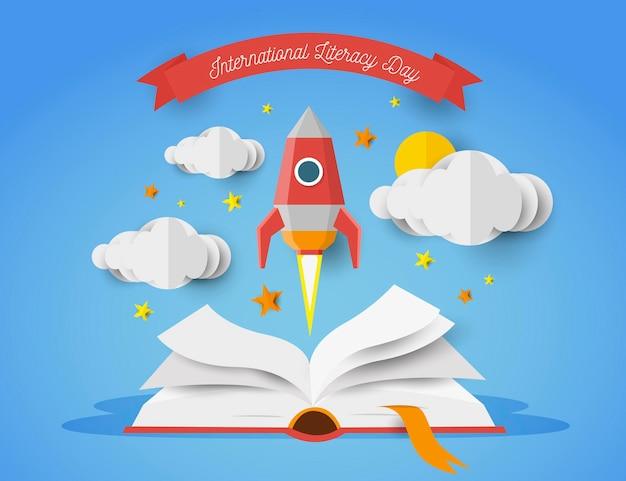 Internationale alfabetiseringsdag in papierstijl met open boek en raket Gratis Vector