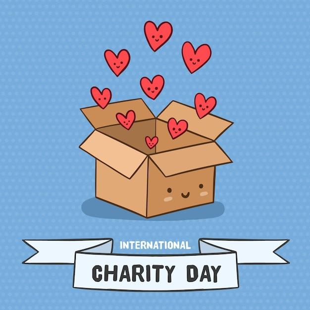 Internationale dag van liefdadigheid met doos van harten Premium Vector