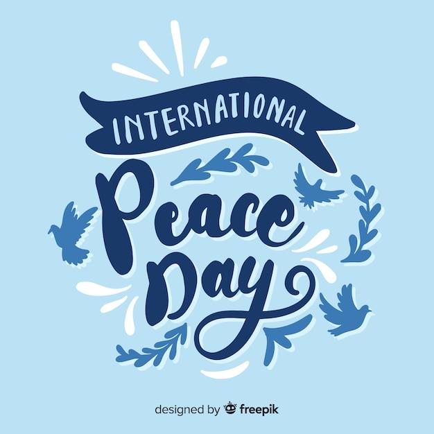Internationale vredesdag belettering Gratis Vector