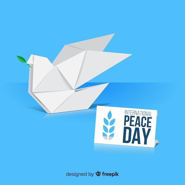 Internationale vredesdag met origamiduif Gratis Vector