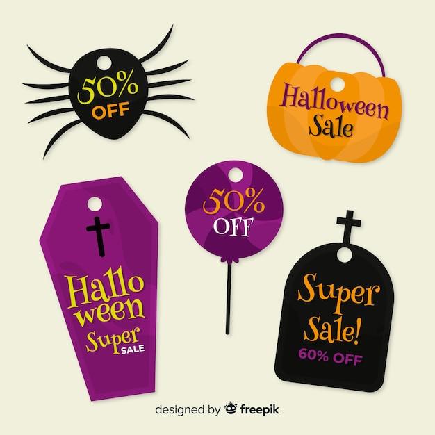 Inzameling van halloween-verkoop bagde op vlak ontwerp Gratis Vector