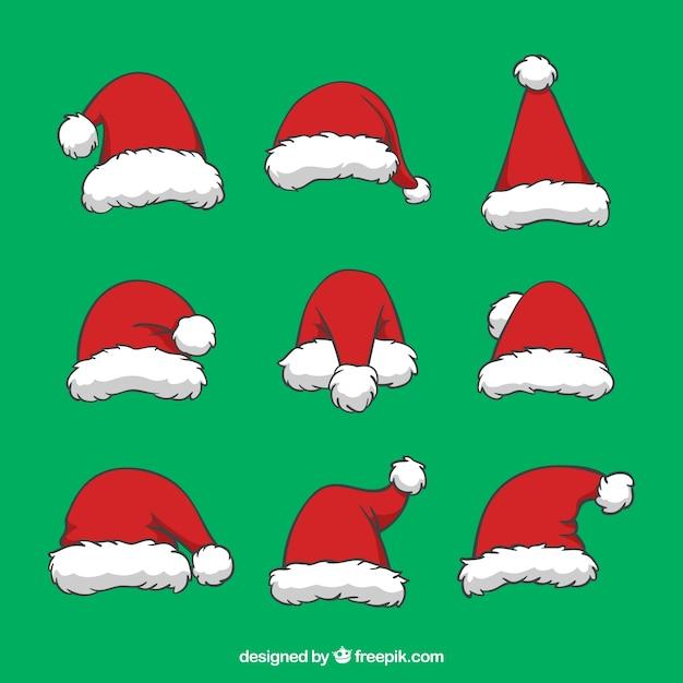 Inzameling van handgetekende kerstmutsjes Gratis Vector