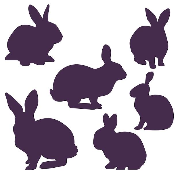 Inzameling van konijntjessilhouetten voor pasen Gratis Vector