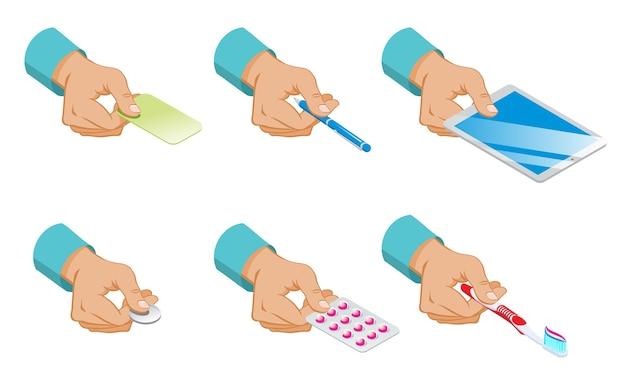 Isometrische mannelijke handen houden set kaart pen tablet munt pillen en tandenborstel geïsoleerd Gratis Vector