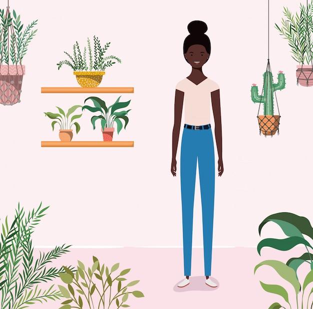 Jong afromeisje in het tuinkarakter Premium Vector