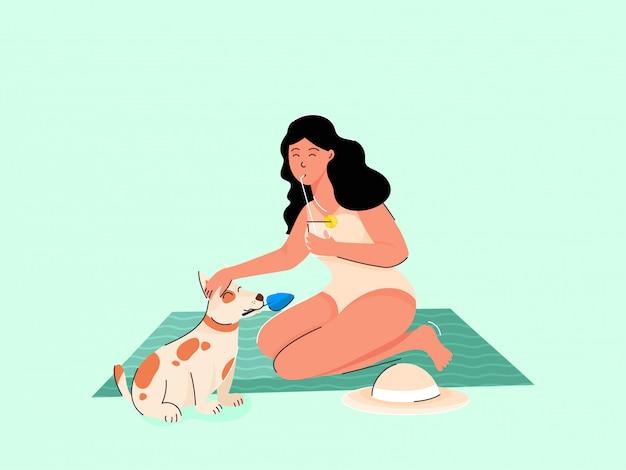 Jong meisje drinken citroensap met hond dier op groene mat of blad. Premium Vector