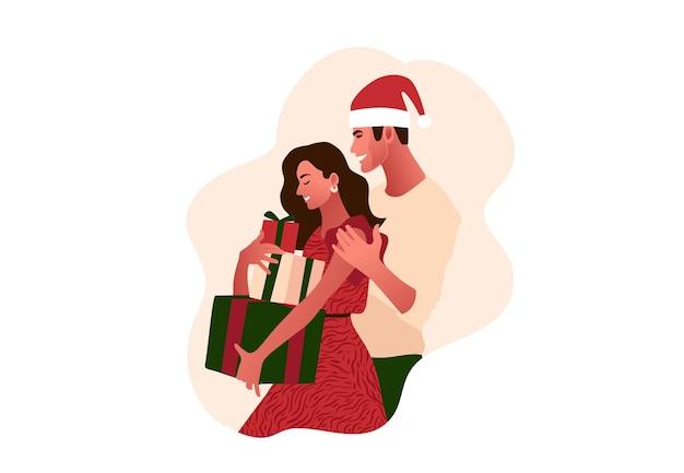 Jong mooi paar dat kerstmis viert. Premium Vector