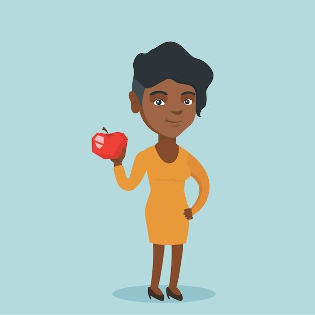 Jonge afro-amerikaanse vrouw die een appel houdt. Premium Vector