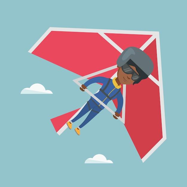 Jonge afro-amerikaanse vrouw die op deltavlieger vliegt Premium Vector
