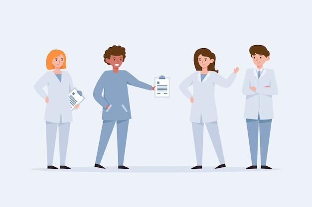 Jonge artsen staan en praten met elkaar Gratis Vector