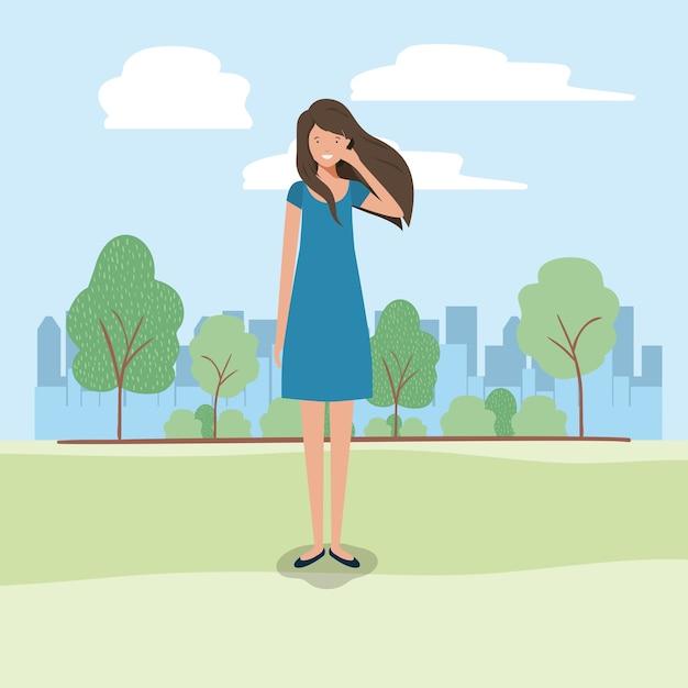 Jonge bedrijfsvrouw met smartphone op het park Premium Vector