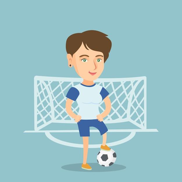 Jonge blanke voetballer met een bal. Premium Vector