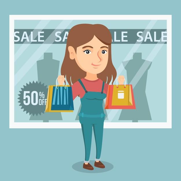 Jonge blanke vrouw winkelen in de uitverkoop. Premium Vector