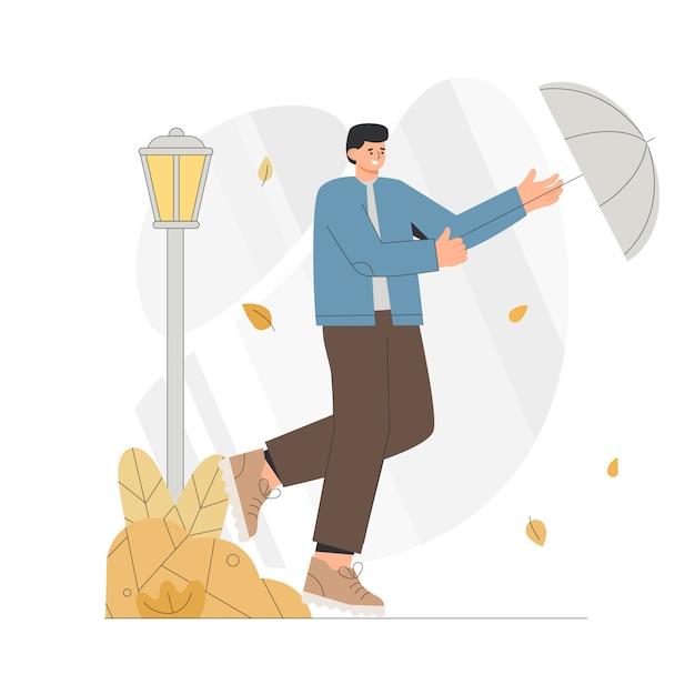 Jonge man loopt met een paraplu in een winderige herfst. Premium Vector