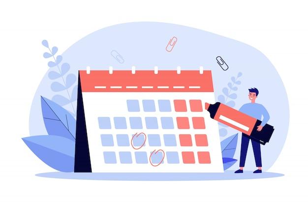 Jonge man met marker controleren van gebeurtenissen in de kalender Premium Vector