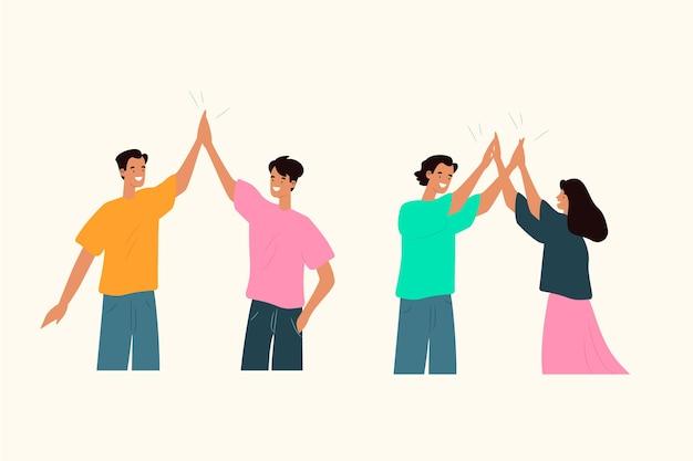 Jonge mensen die high five geven Gratis Vector