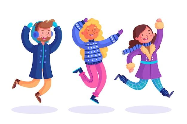 Jonge mensen dragen winterkleren pak springen Gratis Vector