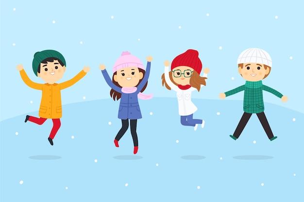 Jonge mensen dragen winterkleren springen collectie Gratis Vector
