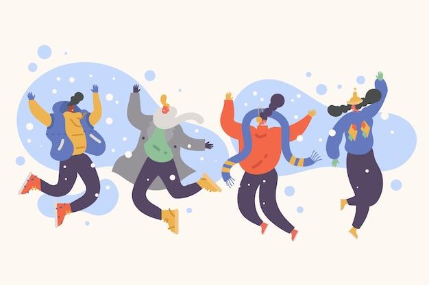 Jonge mensen dragen winterkleren springen Premium Vector