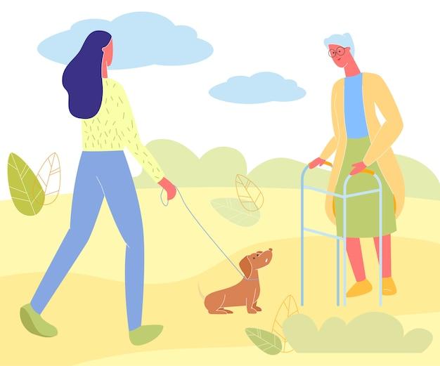 Jonge vrouw met hond en senior dame ontmoeten in park Premium Vector