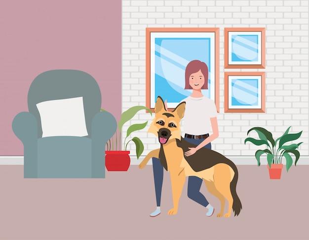 Jonge vrouw met schattige hond in de woonkamer Premium Vector