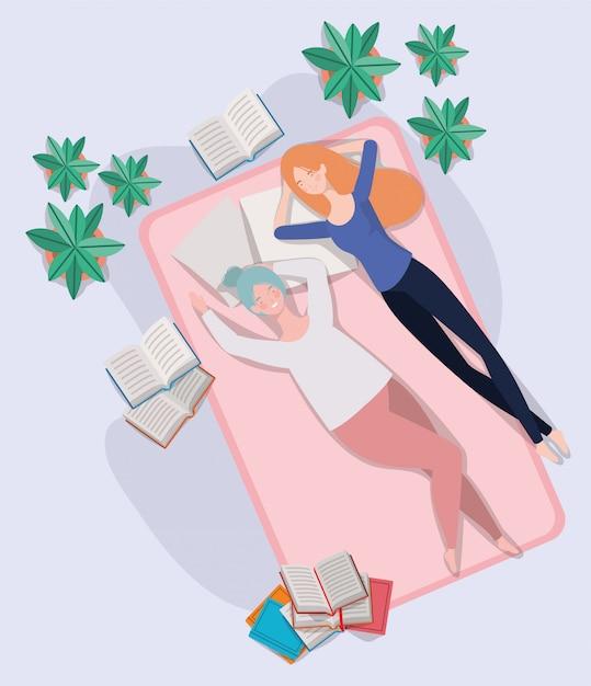 Jonge vrouwen die in matras in de slaapkamer ontspannen Gratis Vector
