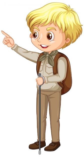 Jongen in verkenner uniform met wandelstok op wit Gratis Vector
