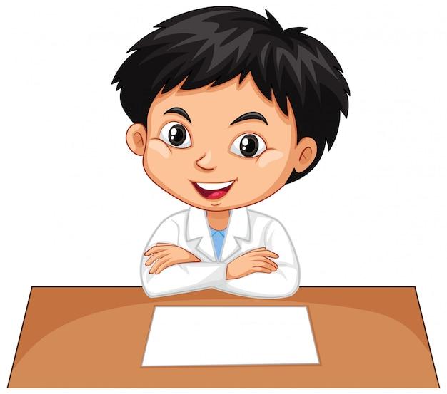 Jongen op het bureau op wit Gratis Vector