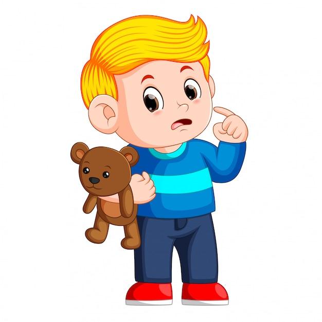 Jongens met schattige bruine teddyberen Premium Vector