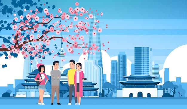 Jongerengroep over seoul city Premium Vector
