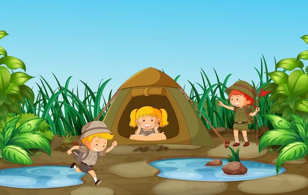 Kamperen kinderen in de natuur Gratis Vector