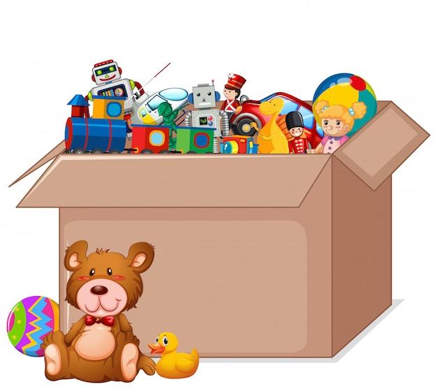 Kartonnen doos vol speelgoed op wit Gratis Vector